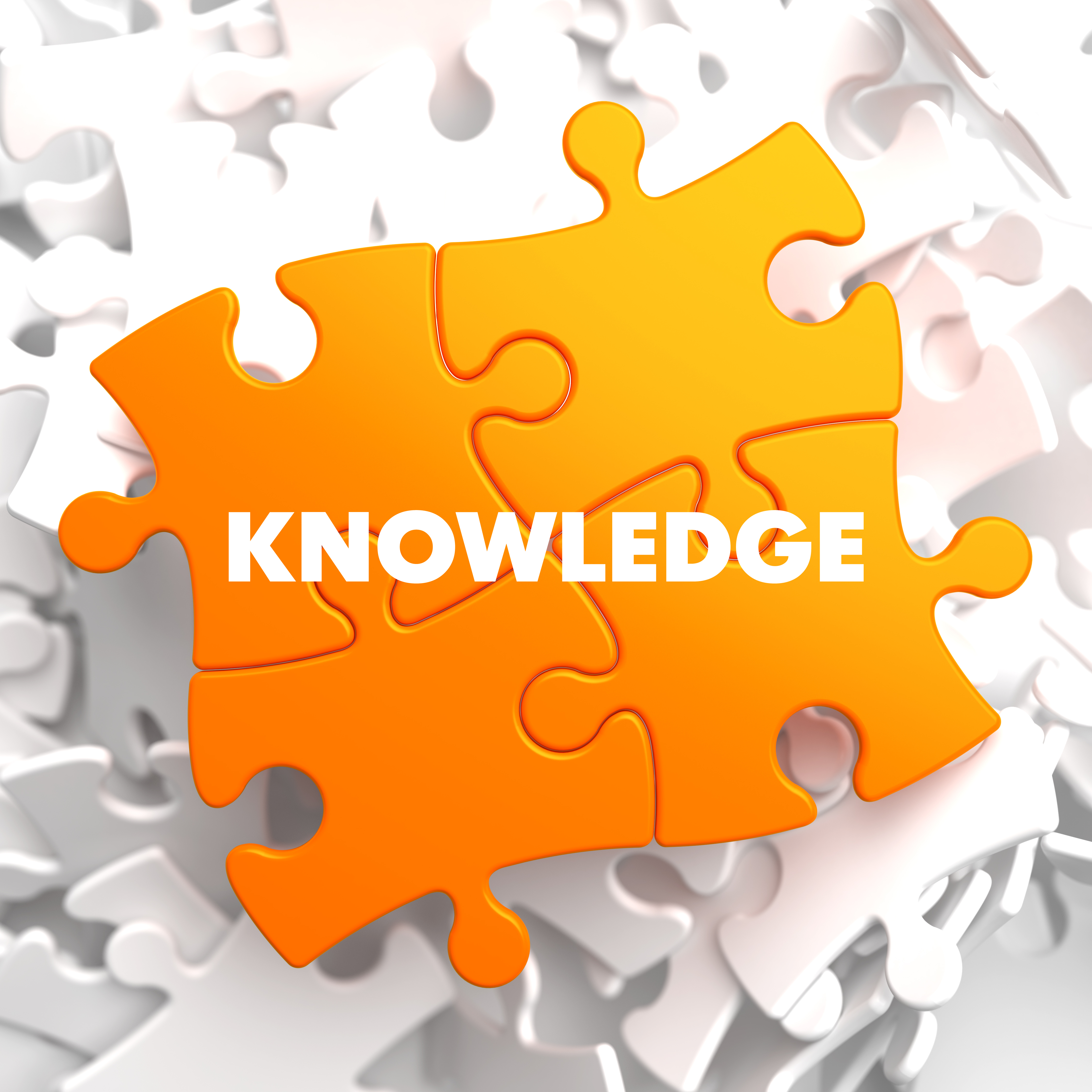 Knowledge on Orange Puzzle on White Background